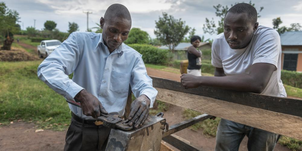 Fixing a handpump in Kabarole district Uganda