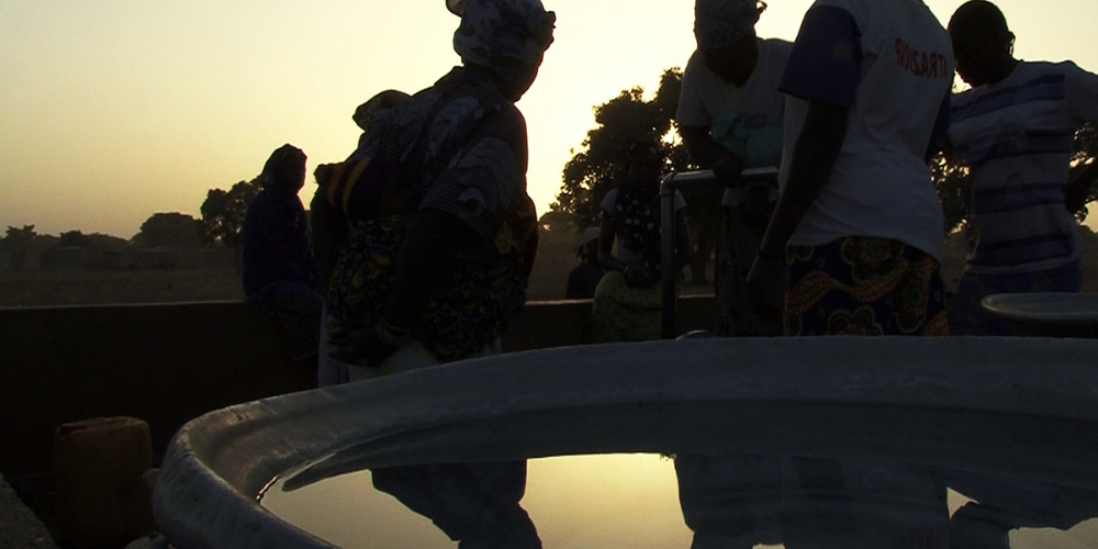 Group at dusk at water barrel
