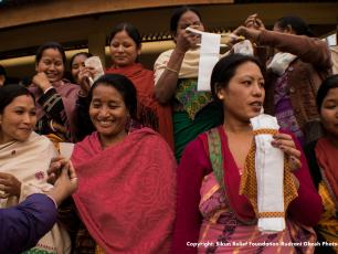 Women in India holding up sanitary products (Photo credit: Rudrani Ghosh photography)