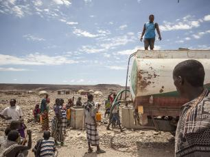 People fetching water at a tanker in Afar, Ethiopia