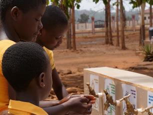 Girls wash hands in Kenyasi Ghana