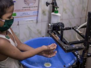 Child washing hand in India