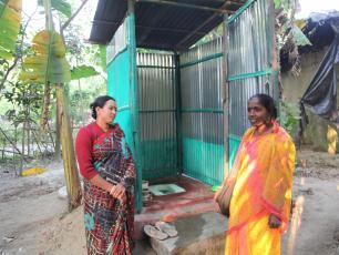 Checking a household latrine in Bangladesh
