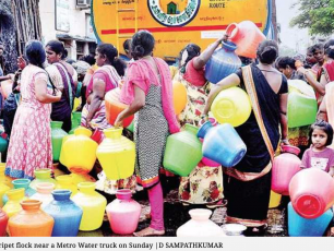 Residents of Chintadripet flock around a water truck