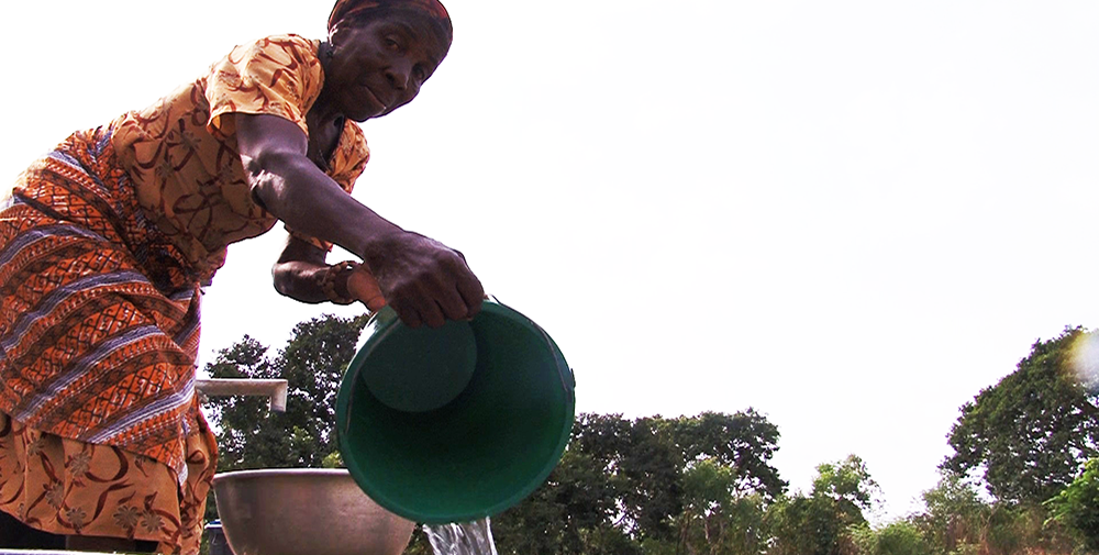 Lady in Ghana pouring water